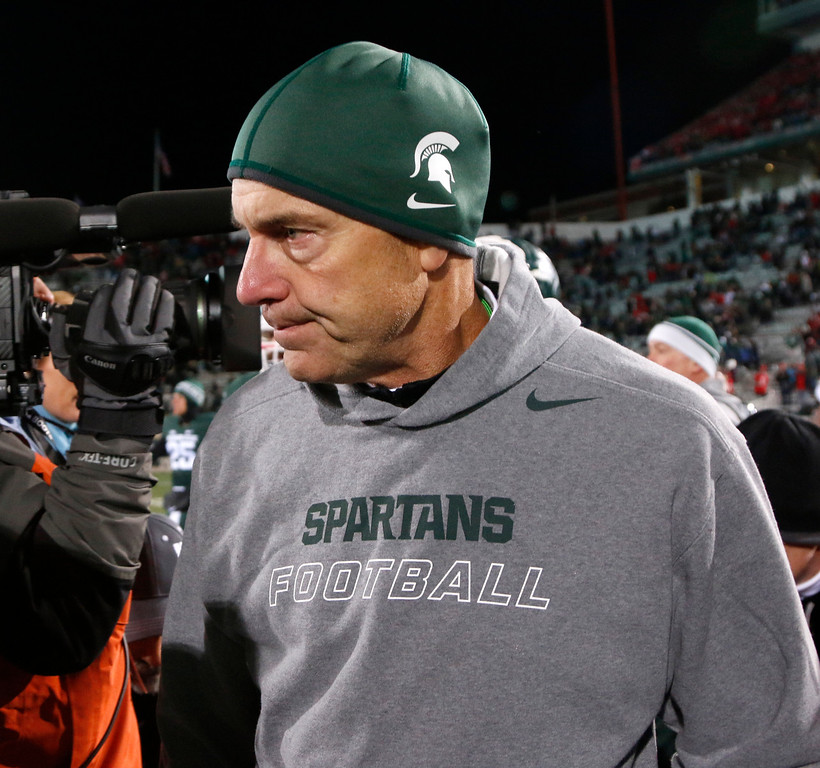 . Michigan State coach Mark Dantonio walks off the field following his team\'s 49-37 loss to Ohio State in an NCAA college football game, Saturday, Nov. 8, 2014, in East Lansing, Mich. (AP Photo/Al Goldis)