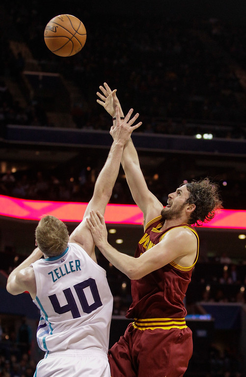 . Cleveland Cavaliers forward Kevin Love shoots over Charlotte Hornets forward Cody Zeller during the second half of an NBA basketball game Wednesday, Feb. 3, 2016, in Charlotte, N.C. Charlotte won 106-97. (AP Photo/Nell Redmond)