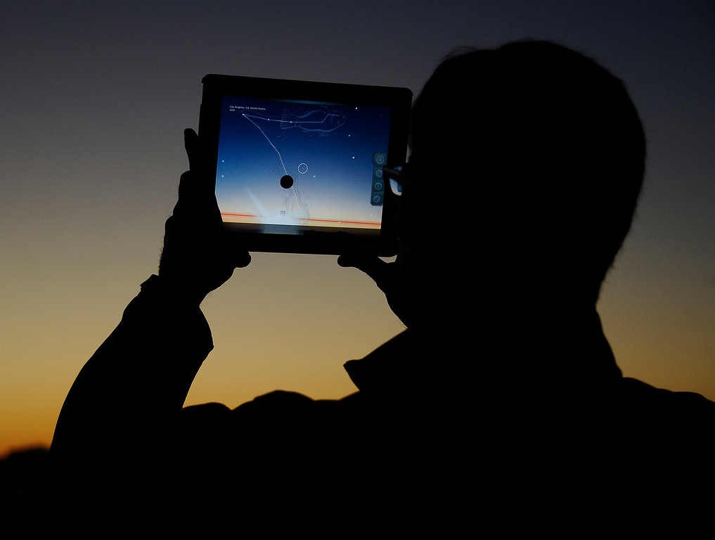 . David Schaefer, from Pasadena, uses his iPad to help him lineup and find the comet Pan-STARRS.  The comet will be visible through the end of March.