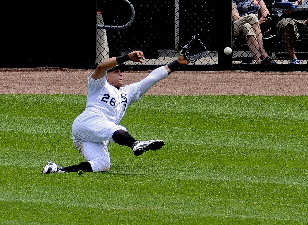 . Chicago White Sox right fielder Avisail Garcia misses a ball hit by Detroit Tigers Tyler Collins during the fourth inning of a baseball game in Chicago on Sunday, June 7,  2015. (AP Photo/Matt Marton)