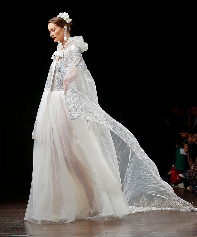 . Bridal fashion from Naeem Khan collection is modeled, Friday, Oct. 6, 2017, in New York. (AP Photo/Bebeto Matthews)