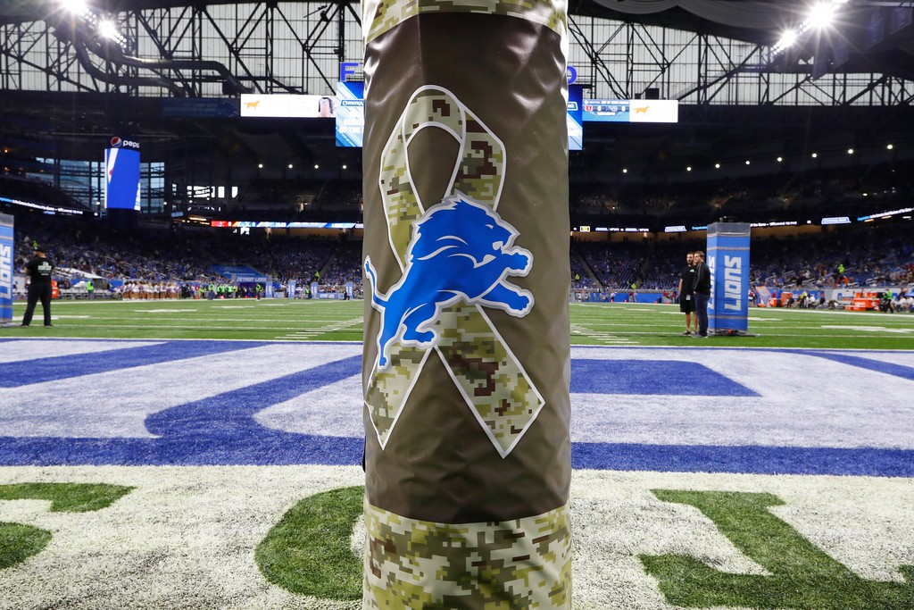 . A Detroit Lions Salute to Service logo is displayed on a goal post during the first half of an NFL football game against the Cleveland Browns, Sunday, Nov. 12, 2017, in Detroit. (AP Photo/Paul Sancya)