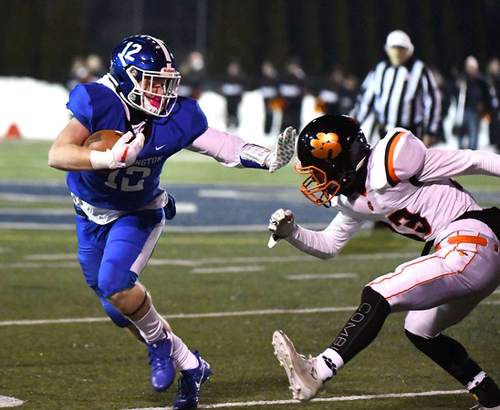 12/4/2019 Mike Orazzi | StaffrSouthingtons Shane LaPorte (12) during the Class LL football playoff with Ridgefield at Southington High School on Wednesday night.