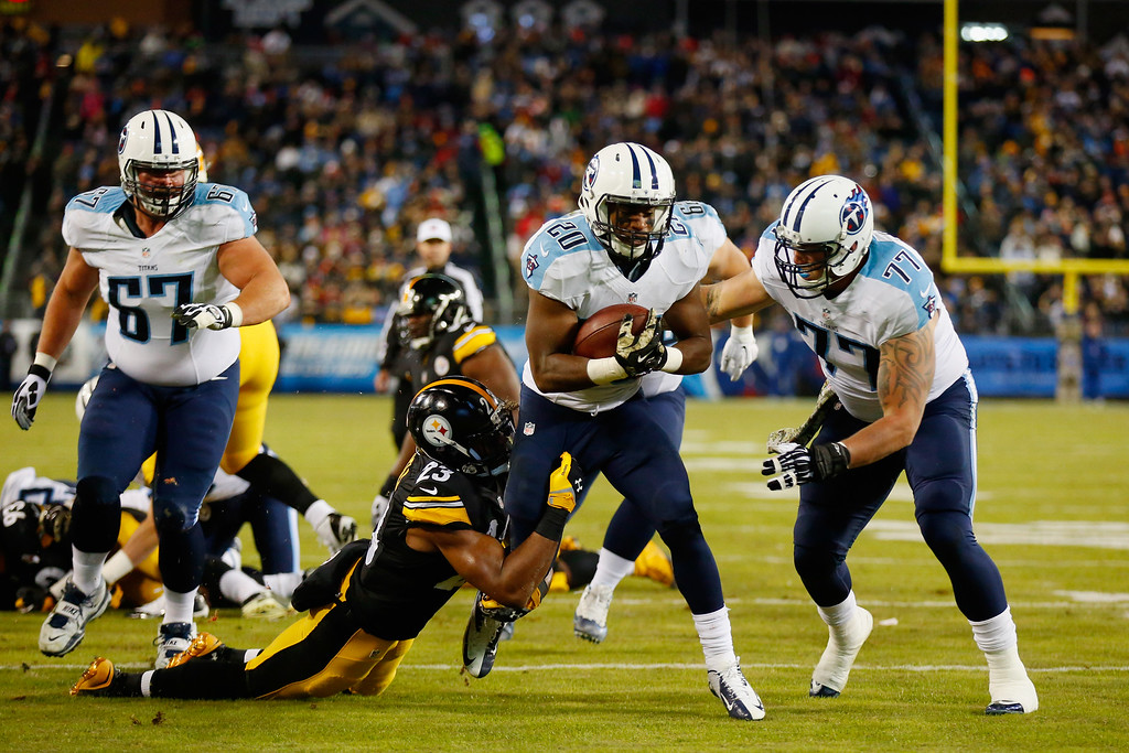 . NASHVILLE, TN - NOVEMBER 17:   Mike Mitchell #23 of the Pittsburgh Steelers attempts to tackle  Bishop Sankey #20 of the Tennessee Titans in the first quarter of the game at LP Field on November 17, 2014 in Nashville, Tennessee.  (Photo by Wesley Hitt/Getty Images)