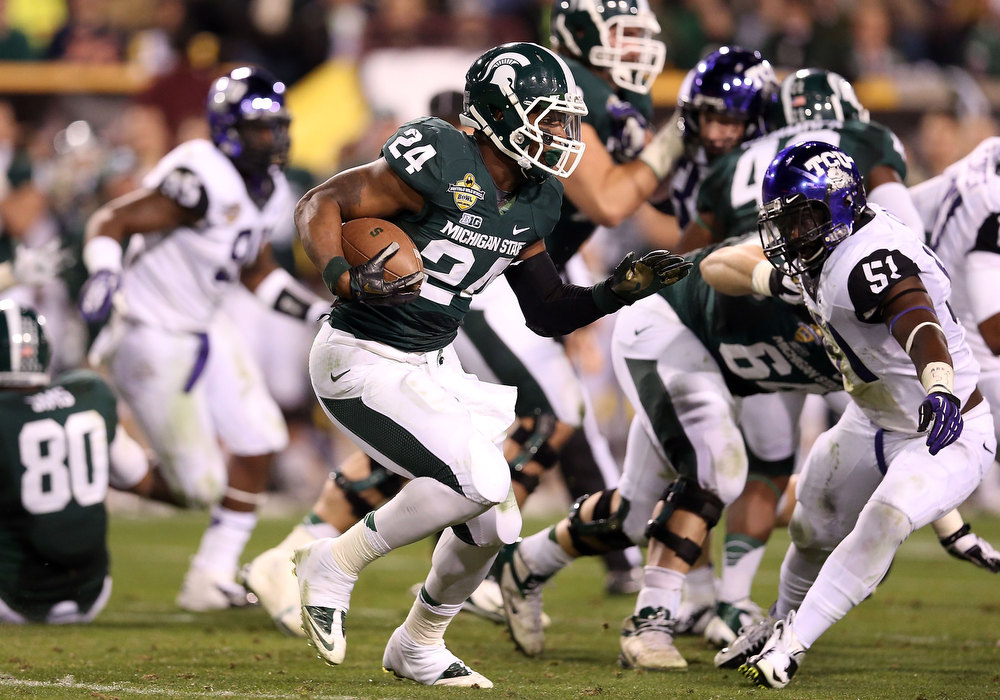 Description of . Running back Le'Veon Bell #24 of the Michigan State Spartans rushes the football against the TCU Horned Frogs during the Buffalo Wild Wings Bowl at Sun Devil Stadium on December 29, 2012 in Tempe, Arizona.  (Photo by Christian Petersen/Getty Images)
