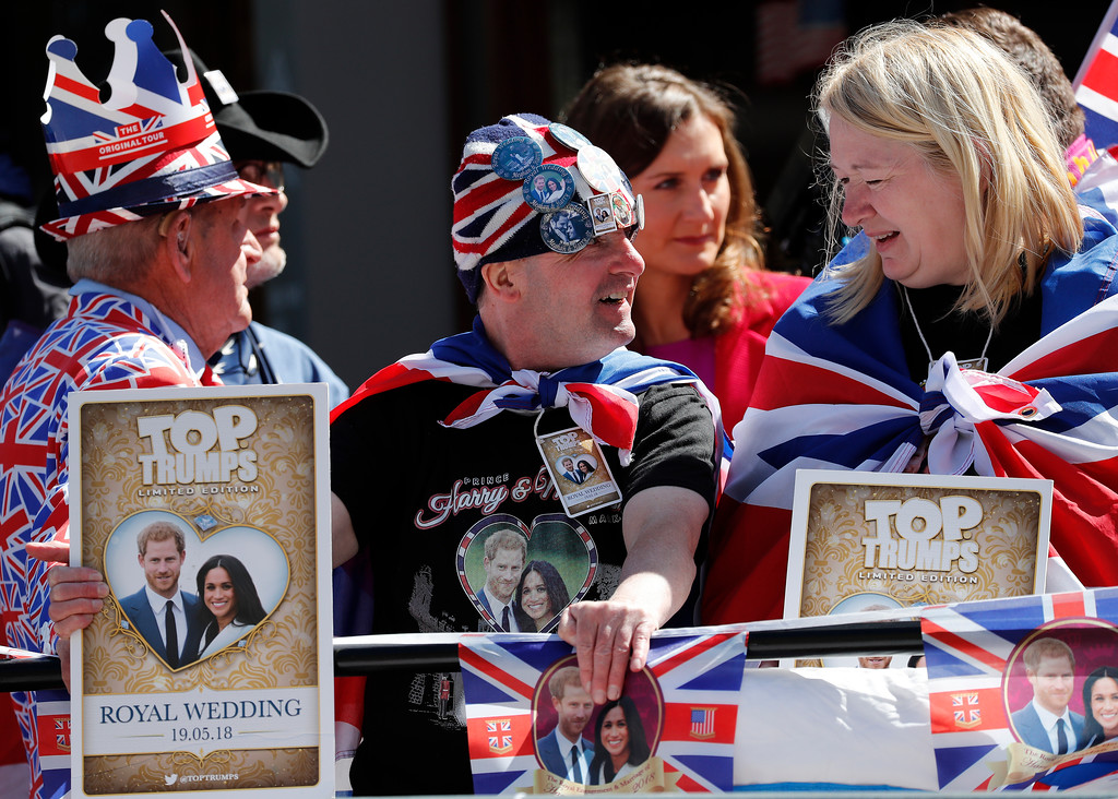 . Royal fans wait to watch a rehearsal of the royal wedding in Windsor, England, Thursday, May 17, 2018. Preparations are being made in the town ahead of the wedding of Britain\'s Prince Harry and Meghan Markle that will take place in Windsor on Saturday May 19. (AP Photo/Frank Augstein)