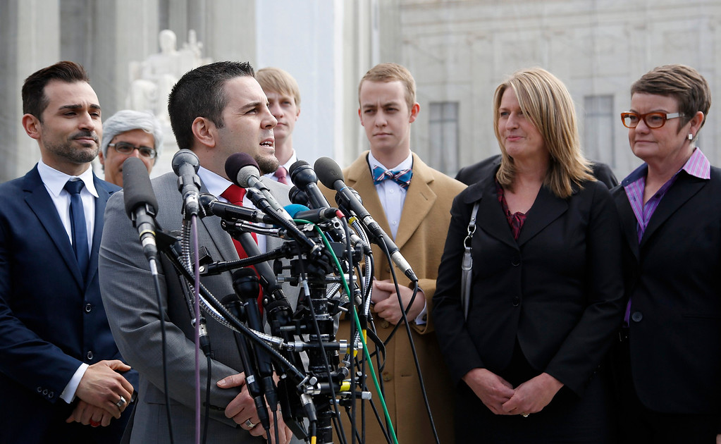 . Plaintiffs Paul Katami (L), Jeff Zarrillo (2nd L), Sandra Stier (2nd R) and Kristin Perry (R) talk to reporters outside the Supreme Court after their case against California\'s Proposition 8 was argued in Washington, March 26, 2013. REUTERS/Jonathan Ernst