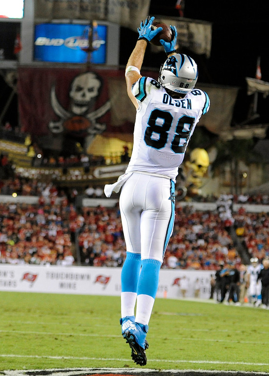 . Carolina Panthers tight end Greg Olsen (88) pulls in a 1-yard touchdown reception during the first quarter of an NFL football game against the Tampa Bay Buccaneers, Thursday, Oct. 24, 2013, in Tampa, Fla. (AP Photo/Brian Blanco)