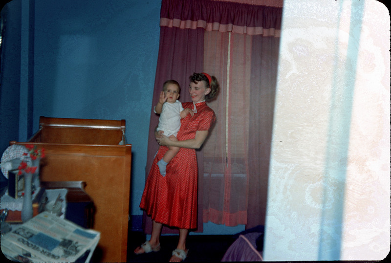 baby richard and mommy by crib.jpg