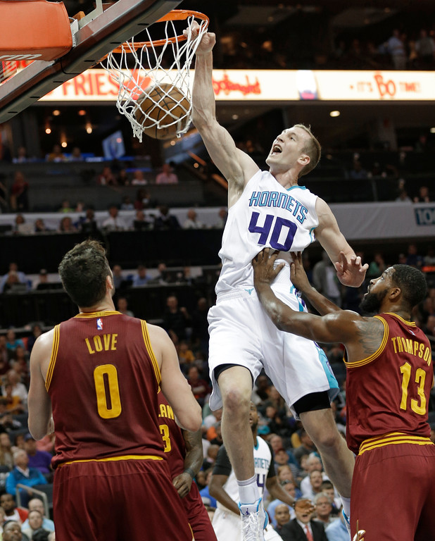 . Charlotte Hornets\' Cody Zeller (40) dunks against Cleveland Cavaliers\' Tristan Thompson (13) and Kevin Love (0) during the first half of an NBA basketball game in Charlotte, N.C., Friday, March 24, 2017. (AP Photo/Chuck Burton)