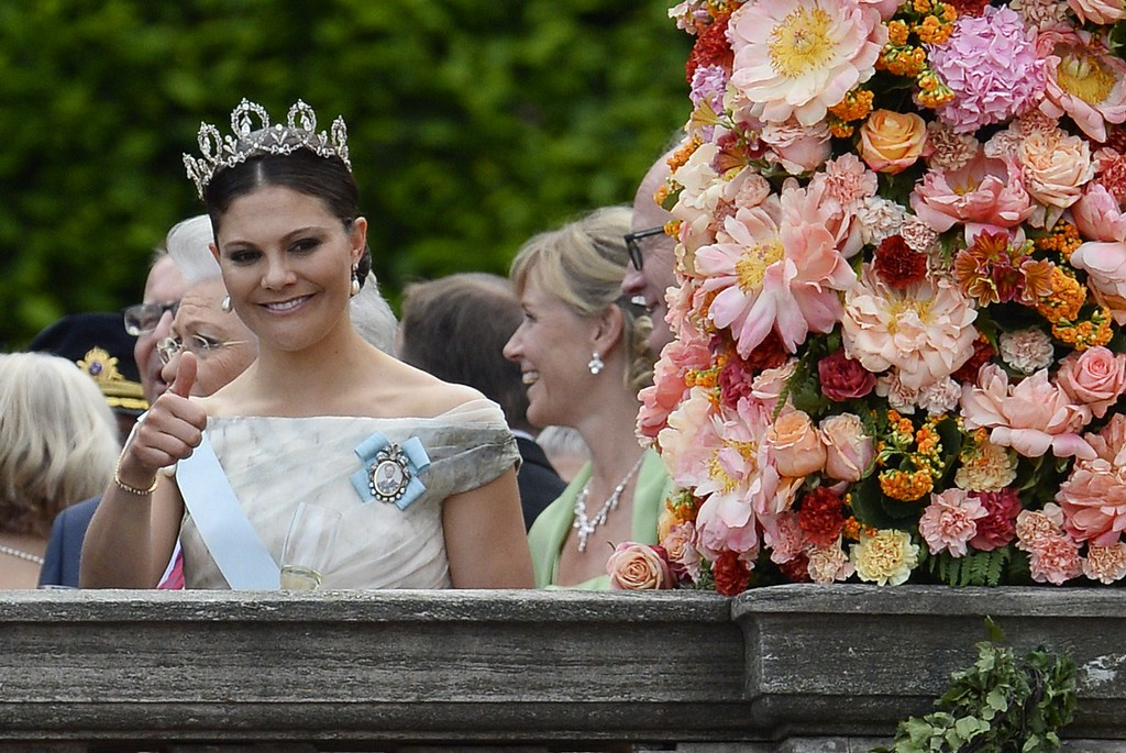. Sweden\'s Crown Princess Victoria gestures outside the Stockholm Palace after the wedding ceremony of Sweden\'s Crown Prince Carl Philip and Sofia Hellqvist on June 13, 2015. AFP PHOTO / JONATHAN NACKSTRAND/AFP/Getty Images