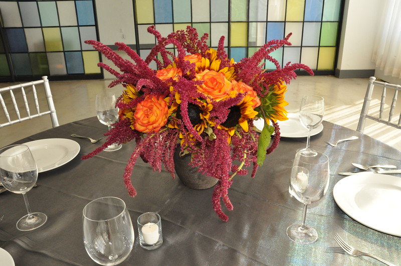 Flower table arrangements at the 404 event space.