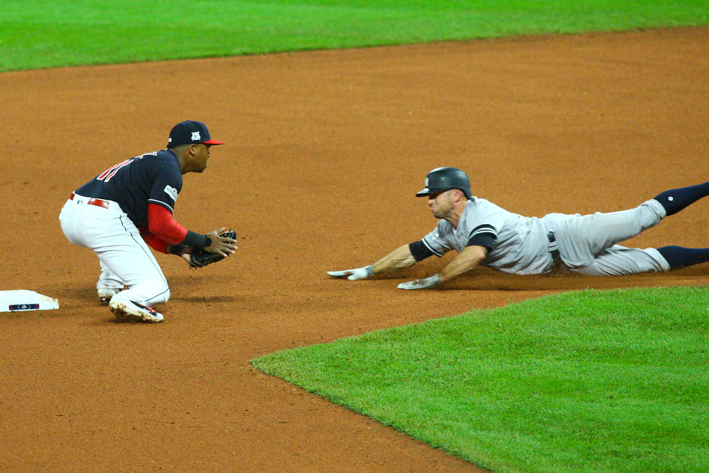 . David Turben - The News-Herald 2017 - Baseball - ALDS Game 5 Quick Pics.  Indians second baseman Jose Ramirez (11) tags out Yankees baserunner Todd Frazier (29) on strike out throw out play.