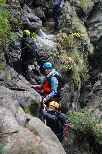 Henry and Ellie climbing in the dry gorge in Zermatt