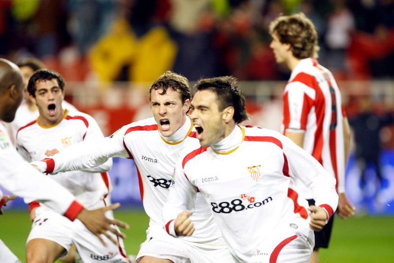 Duscher, Squilachi and Acosta celebrating a Sevilla FC goal. Taken in the Sanchez Pizjuan stadium on 4 Feb 2009 during the King's Cup semifinal game between the football teams Sevilla FC and Athletic Club of Bilbao, town of Seville, autonomous community of Andalusia, southern Spain