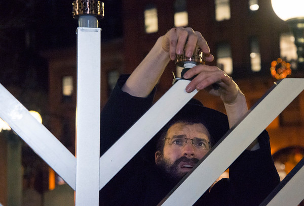 12/26/19 Wesley Bunnell | StaffrrRabbi Yosef Rivkin sets up a Menorah in Central Park on Thursday December 26, 2019 just prior to a small ceremony and lighting.