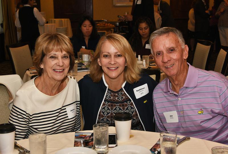 Kathleen Gutmann, center, with Janice and Joe Strang