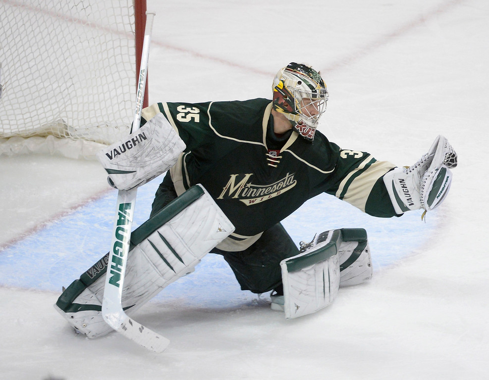 . Minnesota goalie Darcy Kuemper made a save in the second period. The Minnesota Wild hosted the Colorado Avalanche at the Xcel Energy Center in St. Paul Monday night, April 21, 2014. (Photo by Karl Gehring/The Denver Post)