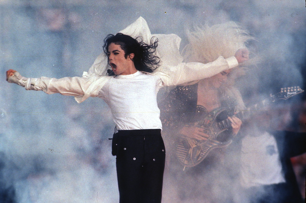 """. This Feb. 1, 1993 file photo shows Pop superstar Michael Jackson performing during the halftime show at the Super Bowl in Pasadena, Calif. Jackson died on June 25, 2009 in Los Angeles, California, just weeks before a planned concert tour billed as his \""""comeback.\"""" (AP Photo/Rusty Kennedy, file)"""