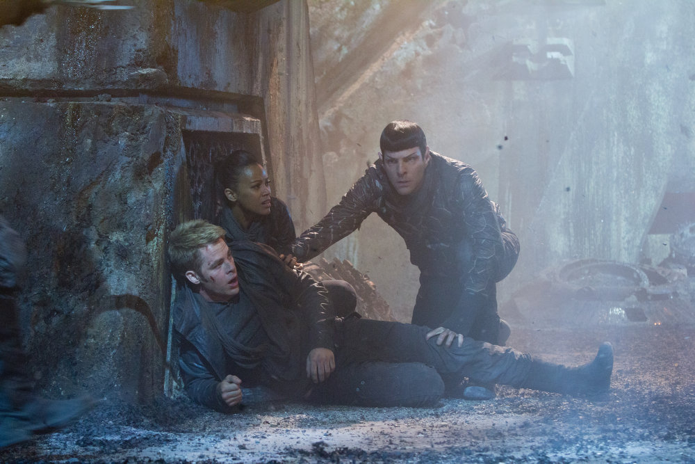 . (Left to right) Chris Pine is Kirk, Zoe Saldana is Uhura and Zachary Quinto is Spock in STAR TREK INTO DARKNESS, from Paramount Pictures and Skydance Productions. (Photo by Zade Rosenthal)