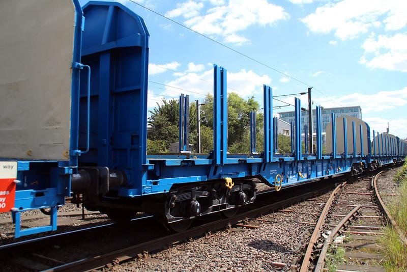 New Colas Log Wagon IWA 83.84.3523045-6 on 6z47 Dollands Moor-Gloucester passing Mitre Bridge Jct 31/08/12.