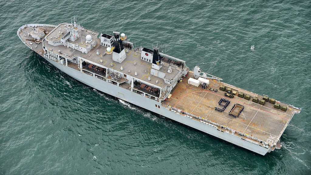 . This handout picture released by the Ministry of Defense shows members of HMS Bulwark\'s ship\'s company form up to create a 90 on the flight deck of the amphibious assault ship on the occasion of Queen Elizabeth II\'s 90th birthday on April 21, 2016 off the coast of Portsmouth.    Britain celebrated the 90th birthday of Queen Elizabeth II today with tributes to a popular monarch who has steered it through the decline of empire and a wave of scandals to the Internet age. / AFP PHOTO / MOD / AFP PHOTO / CROWN COPYRIGHT 2016 / JOEL ROUSE/AFP/Getty Images