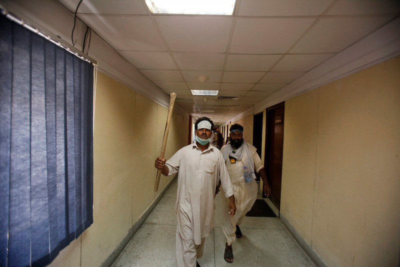 . Pakistani protesters hold sticks after intruding into the state television building in Islamabad, Pakistan, Monday, Sept. 1, 2014. Anti-government protesters and Pakistani police have clashed once again as the demonstrators pushed into a sprawling government complex in the country\'s capital in an effort to try to reach the prime minister\'s official residence. (AP Photo/Anjum Naveed)