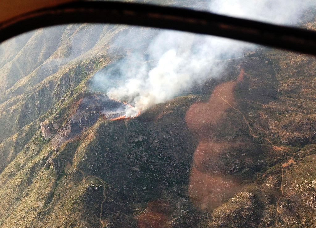 . This June 29, 2013, photo provided by the Arizona State Forestry Division shows an aerial view of the Yarnell Hill Fire, near the town of Yarnell, Arizona, where the 19 firefighters were killed Sunday battling a fast-moving wildfire in Arizona, officials said, in the deadliest incident of its kind in the United States in decades.   (Arizona State Forestry DivisionHO/AFP/Getty Images)
