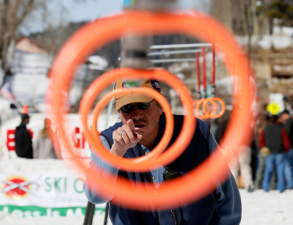 . Jim O\'Neil, a race official, checks the rings before the annual skijoring competition in downtown Leadville, Colorado March 2, 2013.  This was the 62nd year for the competition in Leadville.  REUTERS/Rick Wilking