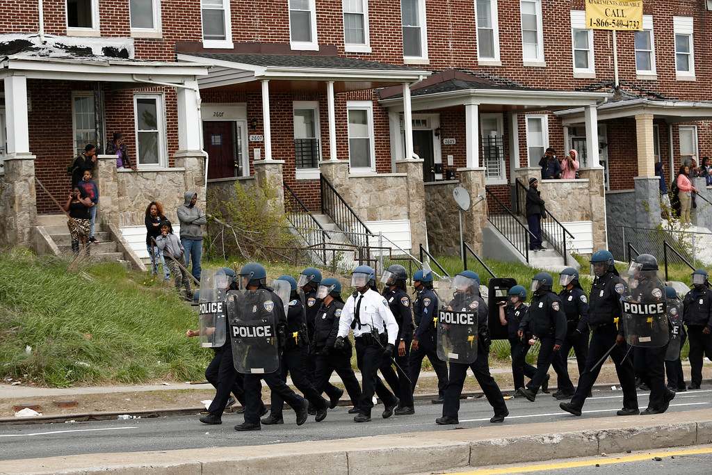 . BALTIMORE, MD - APRIL 27:  Baltimore Police officers walk in formation on Reisterstown Road near Mowdamin Mall, April 27, 2015 in Baltimore, Maryland. The funeral service for Freddie Gray, who died last week while in Baltimore Police custody, was held on Monday morning. (Drew Angerer/Getty Images)