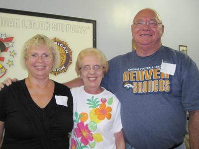 Judi (Neben) Korte, Karen (Kindig) Schlais, and Terry Cogdill pause for a photo.