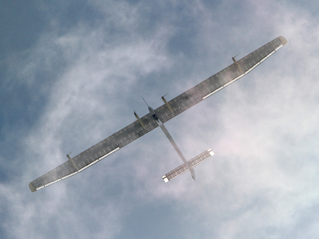 . The Solar Impulse, a solar-powered aircraft, flies over wisps of fog over the Marin Headlands near Sausalito, Calif., on Tuesday, April 23,  2013. The airplane has a wingspan of more than 200 feet.   (Marin Independent Journal/Alan Dep)