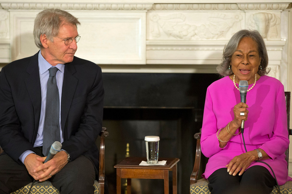 ". Actor Harrison Ford listens at left as Rachel Robinson, 90, widow of baseball great Jackie Robinson talks about her late husband during a workshop for high school and college students based on the movie, ""42,\"" Tuesday, April 2, 2013, in the State Dining Room of the White House in Washington. (AP Photo/Jacquelyn Martin)"