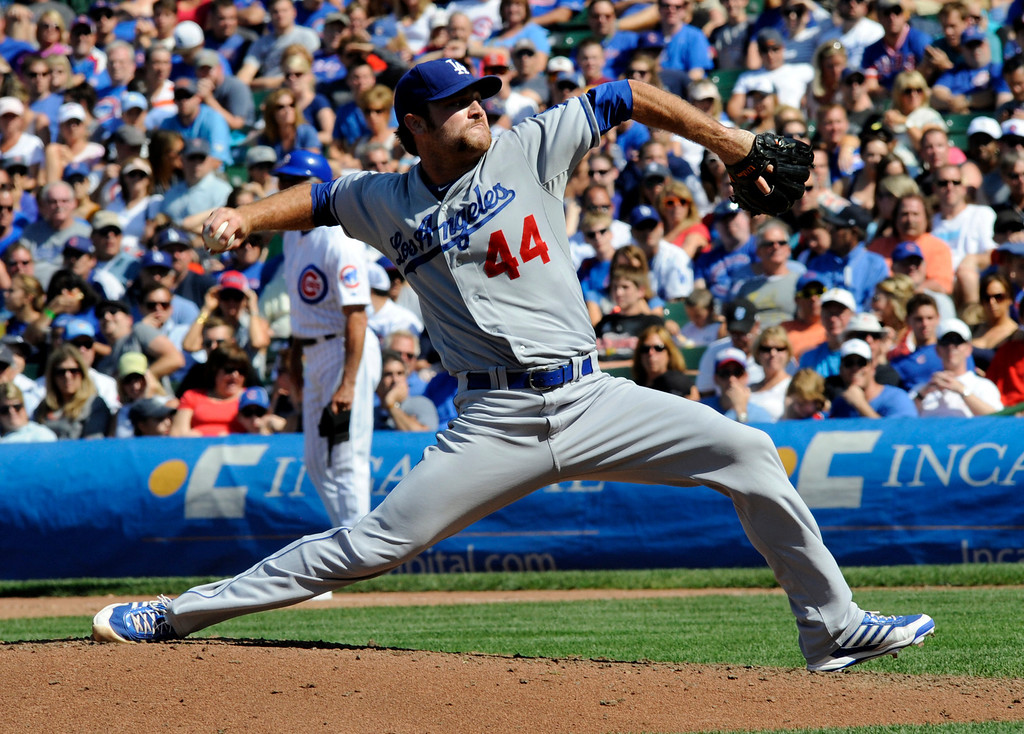 . Los Angeles pitcher Chris Whitlow throws a pitch in the sixth inning of a baseball game between the Chicago Cubs and the Los Angeles Dodgers Sunday Aug. 4, 2013 in Chicago, Ill. (AP Photo/Joe Raymond)