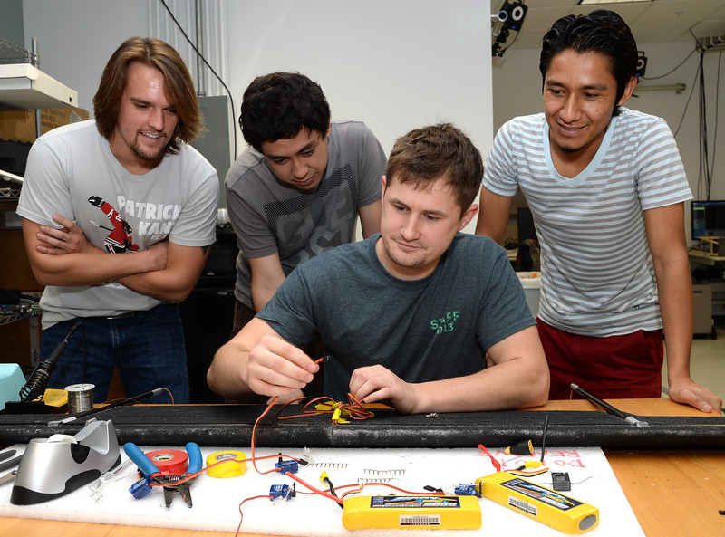 engineering-students-work-on-the-wiring-set-up-for-an-unmanned-aerial-system-project_13896168843_o.jpg