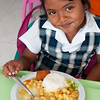 Young girl enjoys a nutritious lunch.