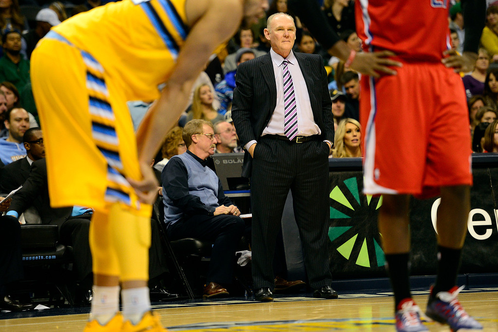 . Denver Nuggets head coach George Karl watches the action against the Los Angeles Clippers during the second half of the Nugget\'s 92-78 win at the Pepsi Center on Tuesday, January 1, 2013. AAron Ontiveroz, The Denver Post