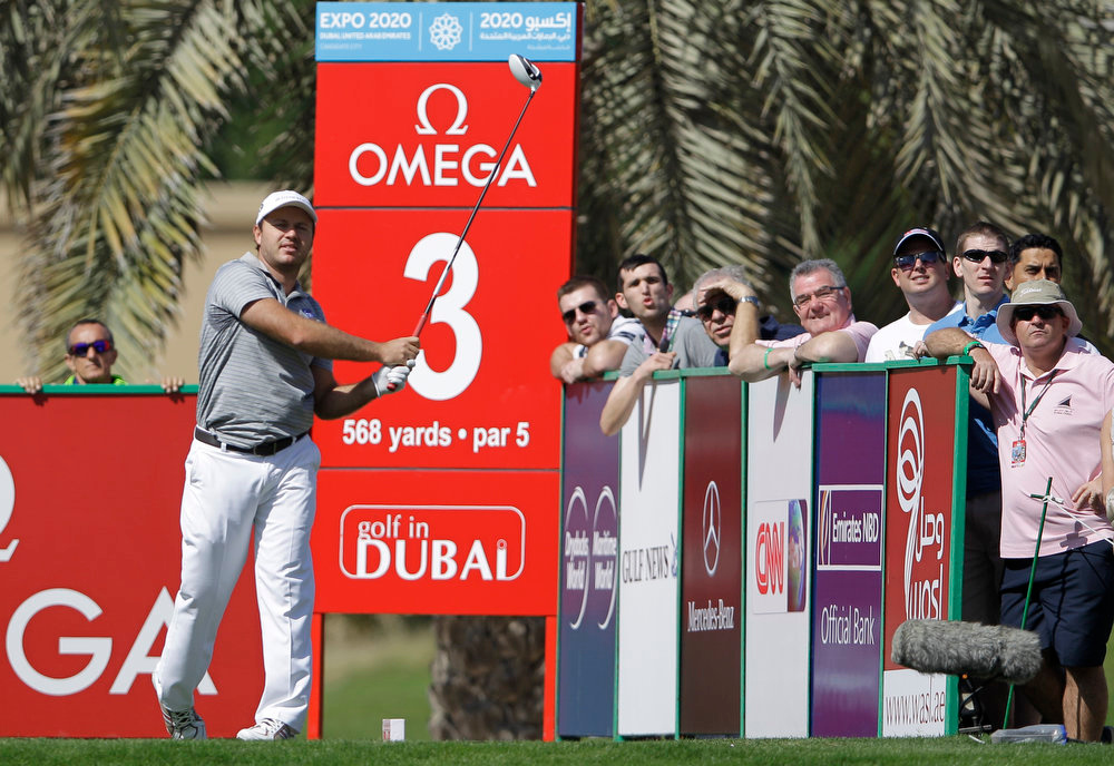 Description of . Richard Sterne from South Africa tees off on the 3rd hole during final round of the Dubai Desert Classic Golf tournament in Dubai, United Arab Emirates, Sunday, Feb. 3, 2013. (AP Photo/Kamran Jebreili)