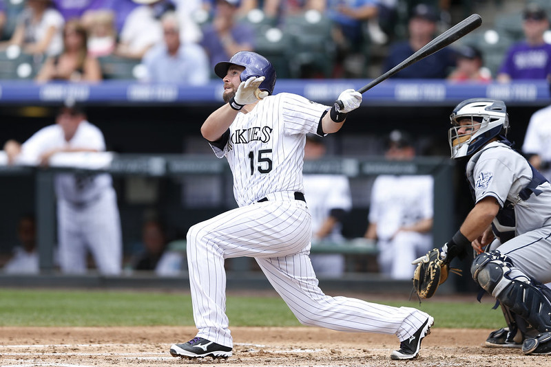 . Jackson Williams #15 of the Colorado Rockies hits a three-run home run in the second inning of the game against the San Diego Padres at Coors Field on September 7, 2014 in Denver, Colorado. (Photo by Joe Robbins/Getty Images)