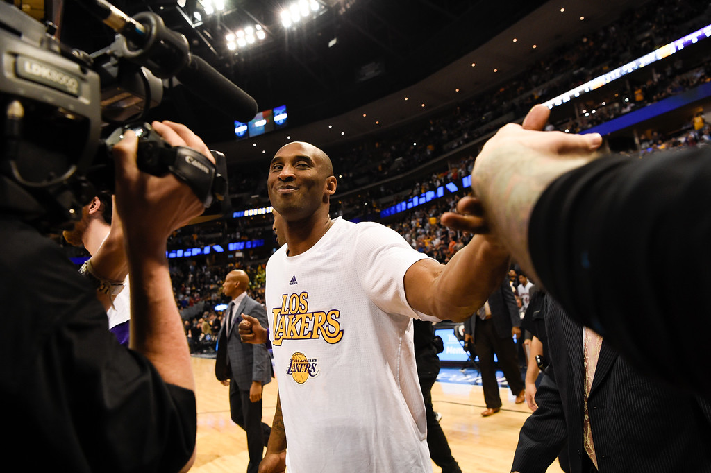 . DENVER, CO - MARCH 02: Los Angeles Lakers forward Kobe Bryant (24) smiles as he leaves the court after the Los Angeles Lakers loss to the Denver Nuggets 117-107 March 2, 2016 at Pepsi Center. Kobe Bryant retires at the end of the season. (Photo By John Leyba/The Denver Post)
