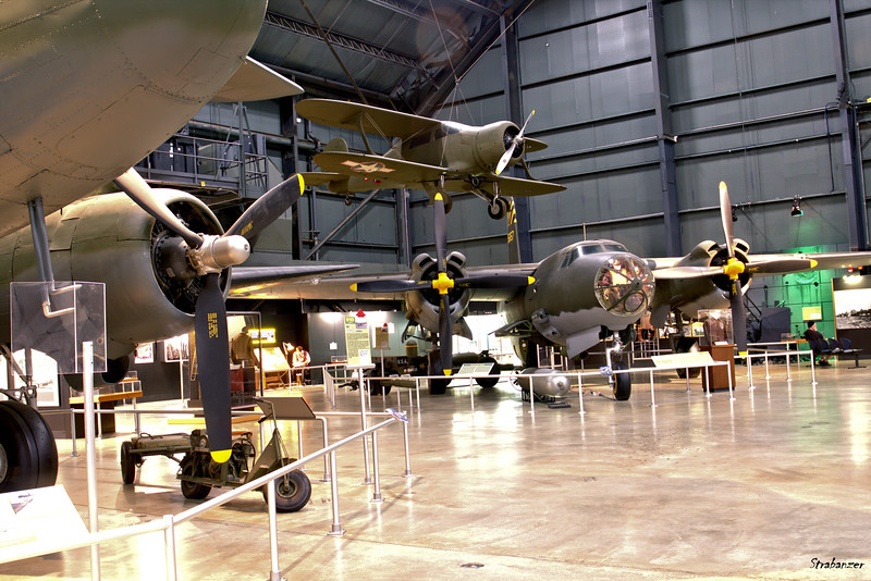 National Museum of the United States Air Force, Dayton, Ohio,   04/12/2019  Martin B-26G-11-MA Marauder, C/N: 8701 43-34581 Painted as a 9th Air Force B-26B assigned to the  387th Bombardment Group Hanging is Beech GB-2 Traveler c/n 6913 painted  as a UC-43 assigned to the 8th Air Force in England   This work is licensed under a Creative Commons Attribution- NonCommercial 4.0 International License.