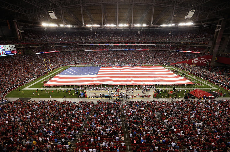 . A large American flag is stretched across the field prior to the NFL game between the Arizona Cardinals and San Diego Chargers at the University of Phoenix Stadium on September 8, 2014 in Glendale, Arizona.  (Photo by Christian Petersen/Getty Images)