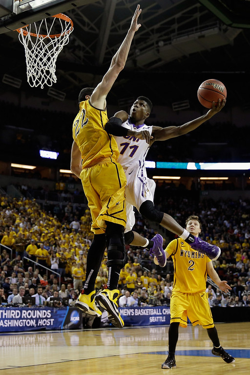 . Wes Washpun #11 of the Northern Iowa Panthers takes a shot against Larry Nance Jr. #22 of the Wyoming Cowboys during the second round of the 2015 Men\'s NCAA Basketball Tournament at KeyArena on March 20, 2015 in Seattle, Washington.  (Photo by Ezra Shaw/Getty Images)