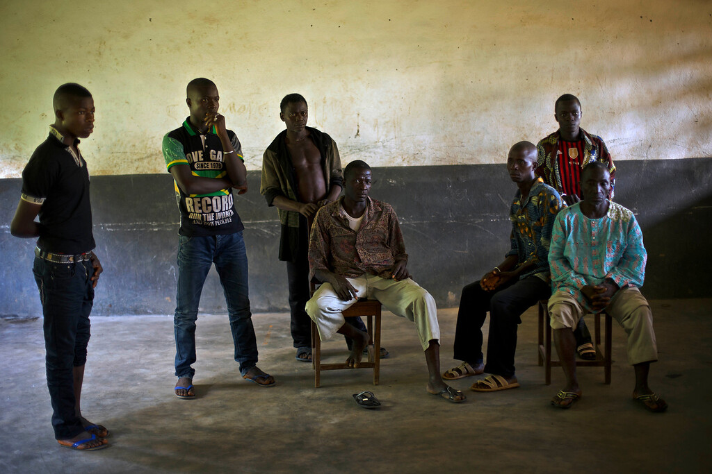 . In this photo taken Thursday Nov. 20, 2014, villagers wait for a distribution of sanitization supplies from UNICEF in the school  in the Guinean village of Meliandou, some 400 miles (600 kms) south-east of Conakry, Guinea, believed to be Ebola\'s ground zero. (AP Photo/Jerome Delay)