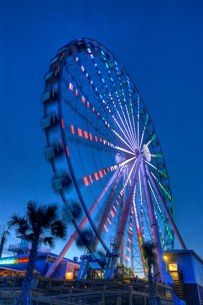 The SkyWheel Myrtle Beach at dusk along the Boardwalk in Myrtle Beach, SC on Friday, March 23, 2012. Copyright 2012 Jason Barnette