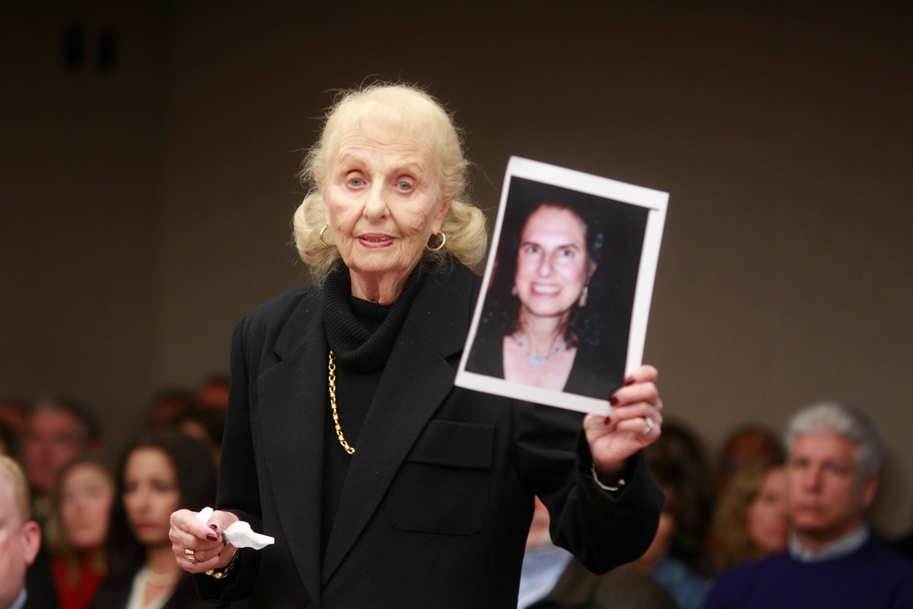 Description of . Marcia Zucker holds up a photo of her late daughter, Helene Seeman, during the sentencing of Amy Locane Bovenizer on Thursday, Feb. 14, 2013 in Somerville, N.J.   Locane-Bovenizer, the former
