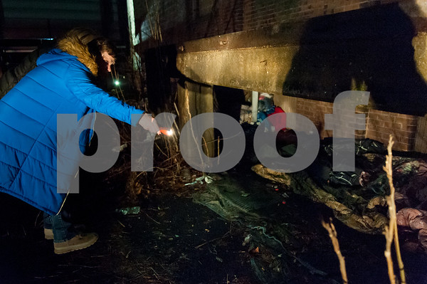 01/23/18 Wesley Bunnell | Staff Volunteers from Connecticut Counts stopped by different parts of New Britain on Tuesday night as part of a larger nationwide effort to take an accurate count of sheltered and unsheltered homeless. Volunteer Holly Ericksen is lit by a cars headlights as she searches the side of a building near Chestnut St.