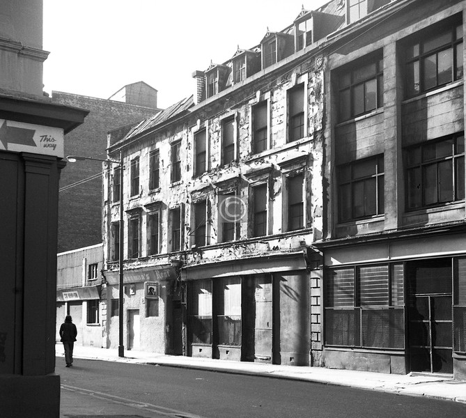 Wilson St, south side east of Brunswick St. The Hangman's Rest was a pub with character.    May 1974
