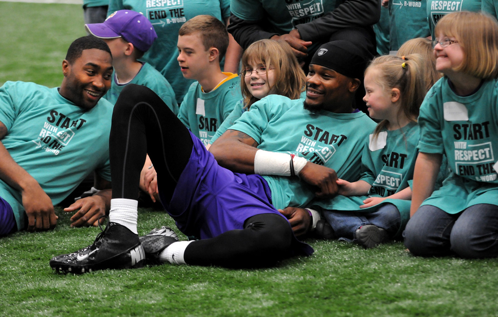 . Vikings players Joe Webb, left, and Jerome Simpson, center, lounge with Minnesota Special Olympics athletes after practice. (Pioneer Press: Jean Pieri)