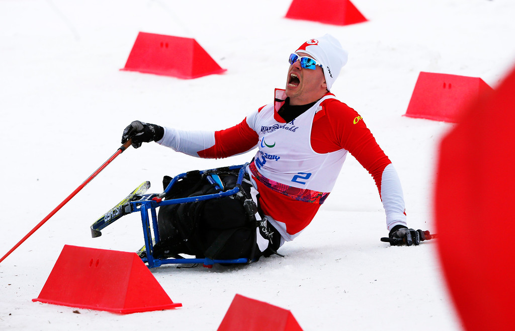 . Sebastien Fortier of Canada crashes during the men\'s 15-kilometer cross country ski sitting event at the 2014 Winter Paralympics, Sunday, March 9, 2014, in Krasnaya Polyana, Russia. (AP Photo/Dmitry Lovetsky)